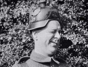 Still from 'Lads of the Village' film 1919 showing man in German helmet winking